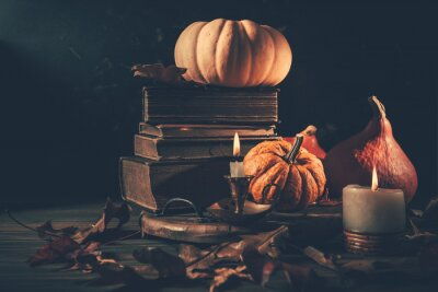 Obraz Still life for Halloween and Thanksgiving with old books, pumpkins and candle