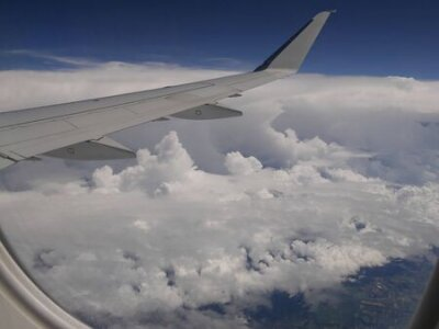 Obraz Storm clouds seen from an airplane window, with an airplane wing in view.