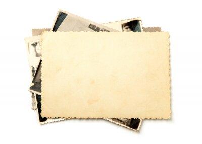 Obraz Stos stare zdjęcia na białym tle. Makieta czystego papieru