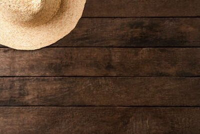 Obraz Straw hat on wooden table. Summer background