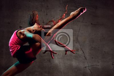 Obraz Street dance girl dancer jumping up dancing in neon light doing gymnastic exercises