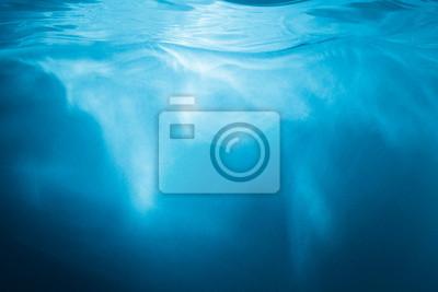 Obraz Streszczenie niebieskim tle. Woda z promieni słonecznych