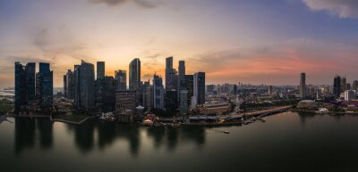 Stunning sunset over the famous Singapore skyline by the Marina in Southeast Asia main financial center