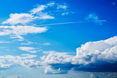 Obraz Summer Blue Sky and white cloud white background. Beautiful clear cloudy in sunlight calm season. Panoramic vivid cyan cloudscape in nature environment. Outdoor horizon skyline with spring sunshine.