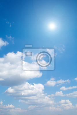 Sun on blue sky with lens flare