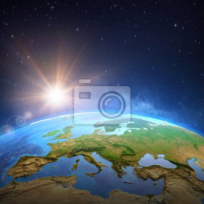 Sun shining over the Earth from space