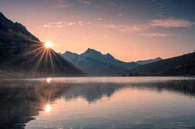 Obraz Sunrise on mountain with foggy in Medicine lake at Jasper