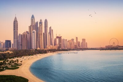 Obraz Sunset view of the Dubai Marina and JBR area and the famous Ferris Wheel and golden sand beaches in the Persian Gulf. Holidays and vacations in the UAE