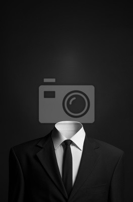 Obraz Surrealizm i biznesu tematem: człowiek bez głowy w czarnym kolorze na ciemnym tle w studio