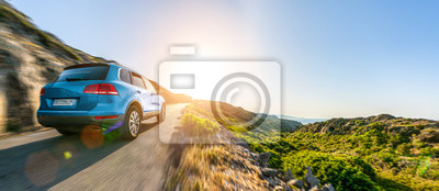 Obraz SUV car in spain mountain landscape road at sunset