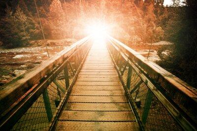 Obraz Światło osnowy na końcu mostu wiszącego przejście pary wodnej w Wil
