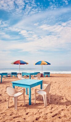 Tables and chairs on a tropical beach, summer vacation concept, color toning applied, Sri Lanka.