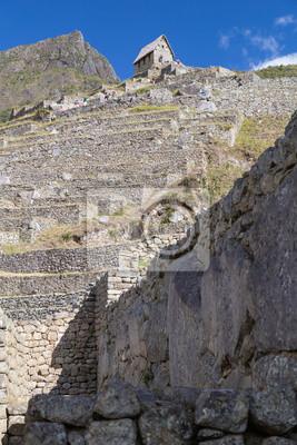 Tarasy i stare ruiny w Machu Picchu, miasta Inków w Peru