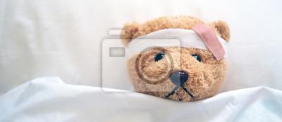 Obraz Teddy bear and bandage. Injury concept
