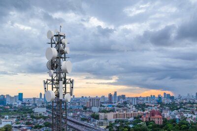 Obraz Telecommunication tower with 5G cellular network antenna on city background