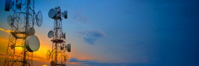 Obraz Telecommunication towers with wireless antennas on sunset sky