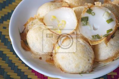 Thai cukierek / Knmcrk, rodzaj tajskiej cukierek, wykonane z mleka kokosowego z cukrem i mąką.