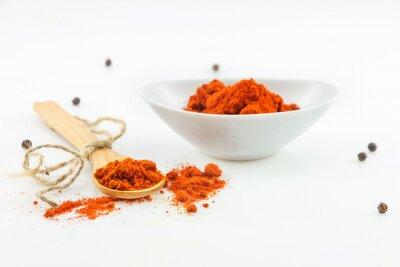 Obraz The paprika spices on white background.