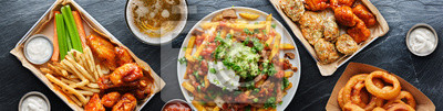 Obraz top down photo of carne asada fries and buffalo chicklen wings