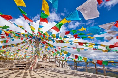 Top of the Shika Snow Mountain (4500 meters above the sea level) with Buddhist prayer flags, China.