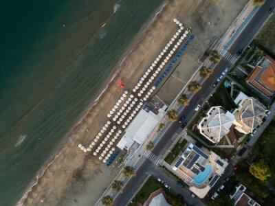 Obraz Top view of a coastal town with a beach and beach umbrellas. Terracina, Province of Latina, Lazio Region, Italy