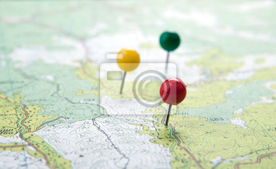 Obraz topographic map with colored needles pushpins close up