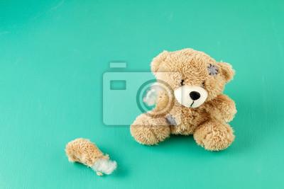 Obraz Toy teddy bear with teared away paw