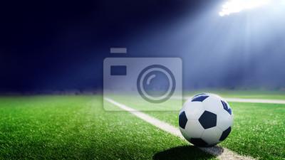 Obraz Tradition soccer ball illumintaed by stadium lights