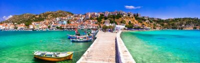 Traditional colorful Greece - travel in beautiful Samos Island, scenic Pythagoion town. view with traditional boats