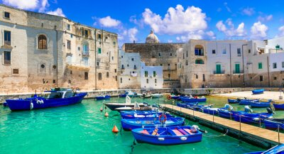 Traditional Italy - white town Monopoli with colorful fishinng boats. Puglia, Italy