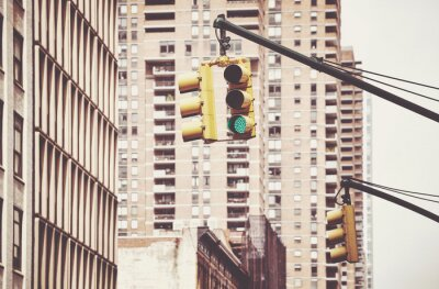 Traffic light in New York City, color toning applied, USA.