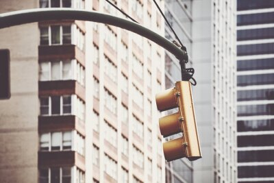 Traffic light in New York City, selective focus, color toning applied, USA.