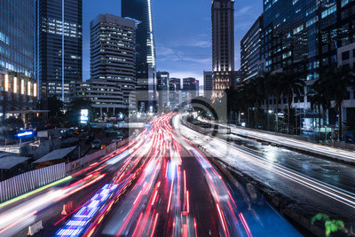 Traffic rushing in Jakarta business district at night in Indonesia capital city