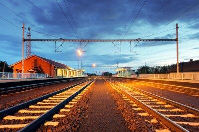 Obraz Train station in motion blur at night, railroad
