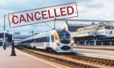 Trains cancelled due to pandemic of coronavirus. Passenger railway travel and transportation cancellation due to epidemic of Covid-19.  Background with railway station, high speed train and text