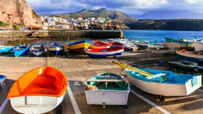 travel in Grand Canary island - traditional fishing village Puerto de Sardina with old colorful boats