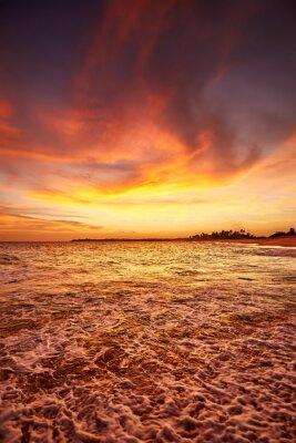 Tropical beach at a beautiful sunset.