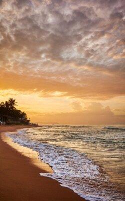 Tropical peaceful beach at sunrise.