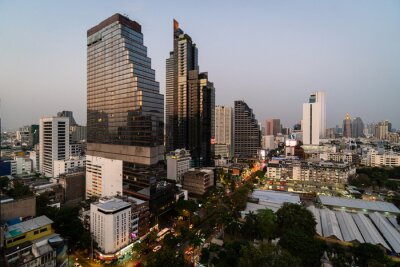 Twilight over Bangkok Silom business district with modern hotels and office tower in Thailand capital city in Southeast Asia