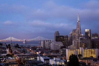 Twilight over San Francisco downtown and financial district from Russian hill with the San Francisco Auckland Bay bridge in California, USA