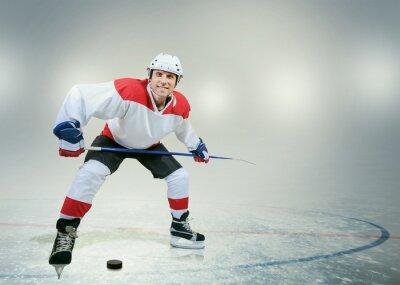 Obraz Uśmiecha hokeista na lodzie