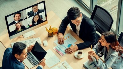 Obraz Video call group business people meeting on virtual workplace or remote office. Telework conference call using smart video technology to communicate colleague in professional corporate business.