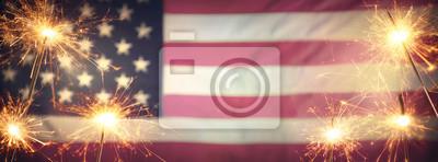 Obraz Vintage Celebration With Sparklers And Defocused American Flag - 4th Of July