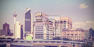 Vintage retro filtered Kuala Lumpur skyline.