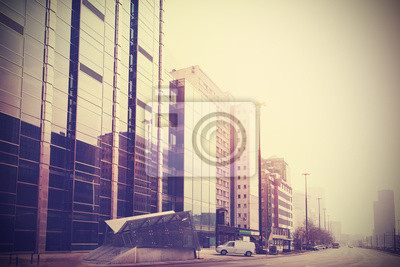 Vintage retro filtered picture of modern downtown.