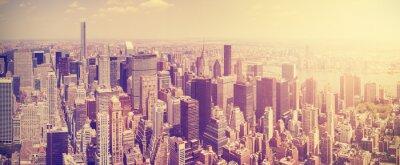 Obraz Vintage stonowanych Manhattan Skyline o zachodzie słońca, NYC, USA.