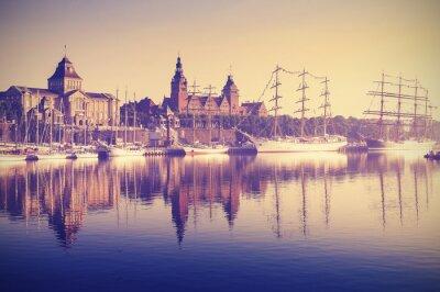 Vintage style sailing ships at sunrise in Szczecin.