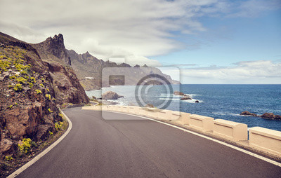 Vintage toned picture of a scenic ocean drive road.