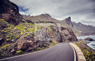 Vintage toned picture of a scenic ocean drive road, Tenerife, Spain.
