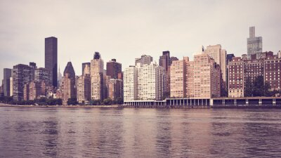 Vintage toned picture of New York East Side waterfront, USA.